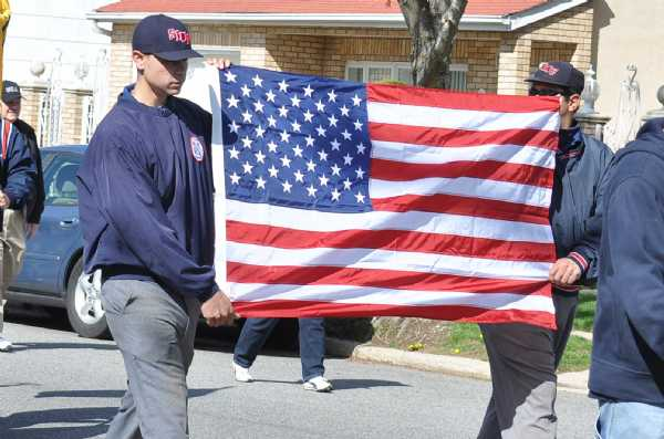 Umpires carrying the American Flag during the 2010 Parade