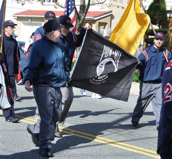 Umpires carriying the POW Flag during the 2010 Parade