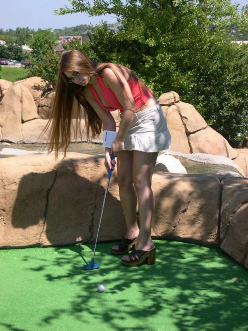 Jaclyn Lijewski putts on the evil 10th at Action Territory. Why does her hair always look like that in pictures?