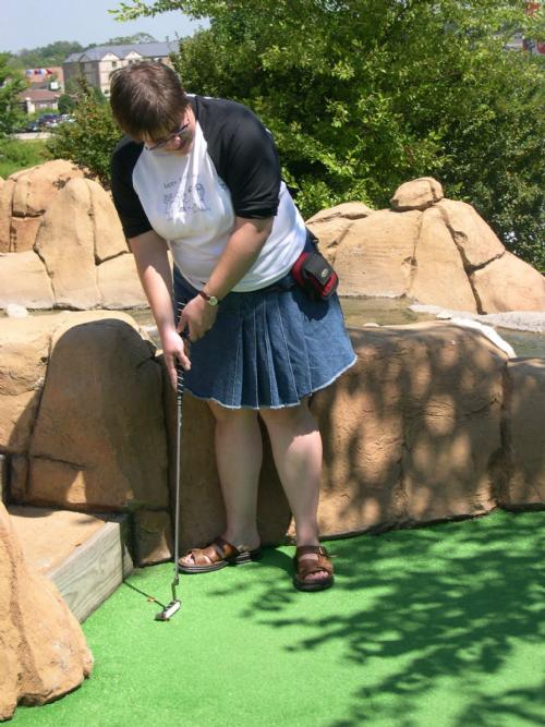 Sharon Bull, one of the day's 3 skirted participants, putts at Action Territory.