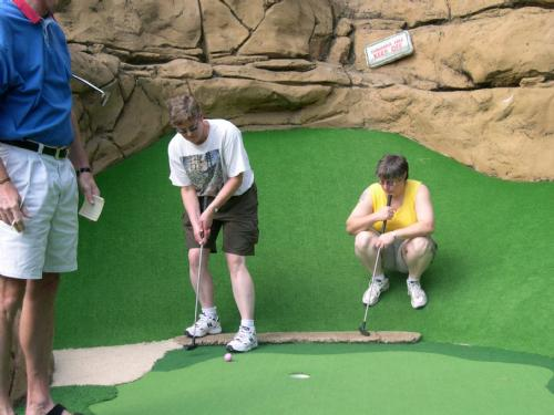 Vicki Brown putts as Anne Marie Provenzano studies the break of the green on Congo River's 12th hole.