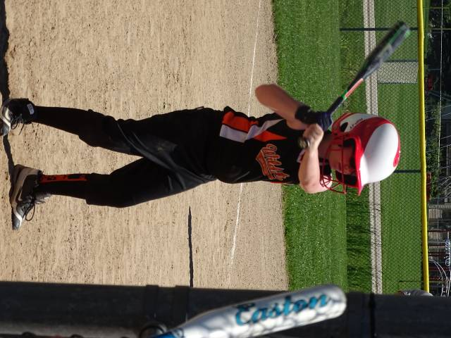 Maddie taking some warm up swings, getting ready to score some runs!