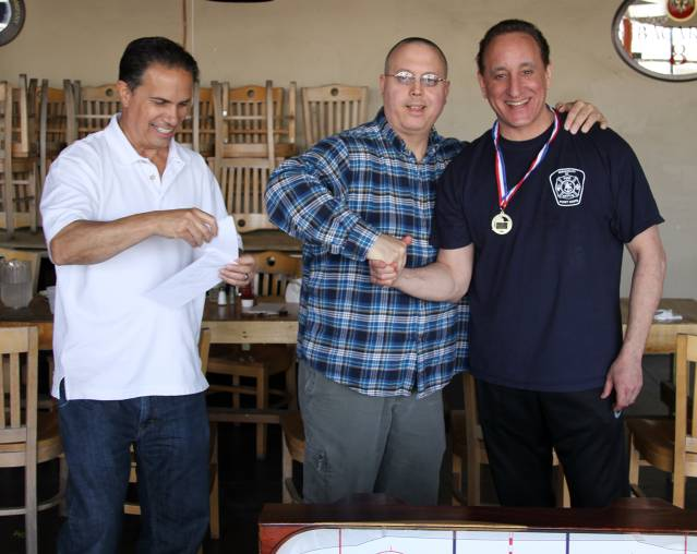 This guy (on the far right) not only brought us these great games, but was the most fun opponent when behind the rods!  John F (far right).