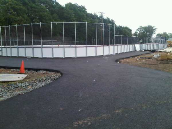 August 2, 2010 - The boards around the rink are now complete, including the penalty box and bench areas. New fence posts have also been put up. (Photo: R. Baum)