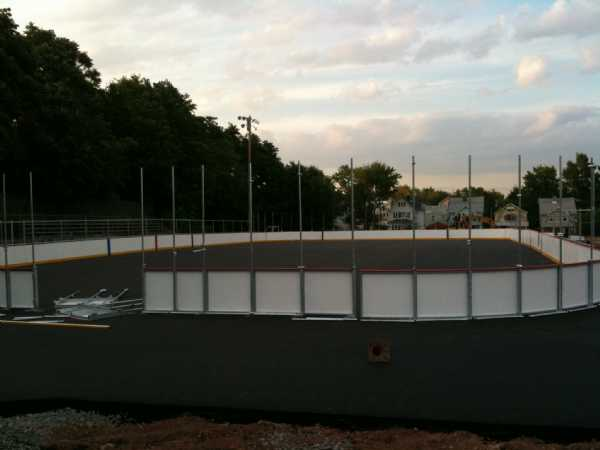 July 31, 2010 - The rink continues to take shape as new boards and fence posts are installed.