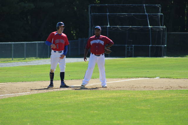 "The IronPigs' Frankie Trinidad yakking it up and Bisons' Sergio Hebra ""adjusting"" it up at third base"