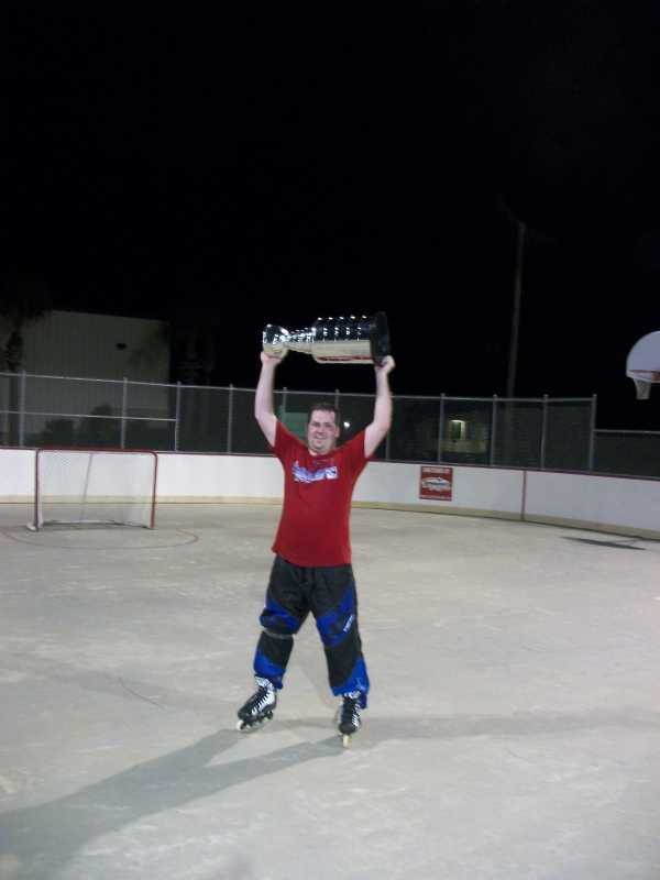 Kenny Glass celebrates with the cup.
