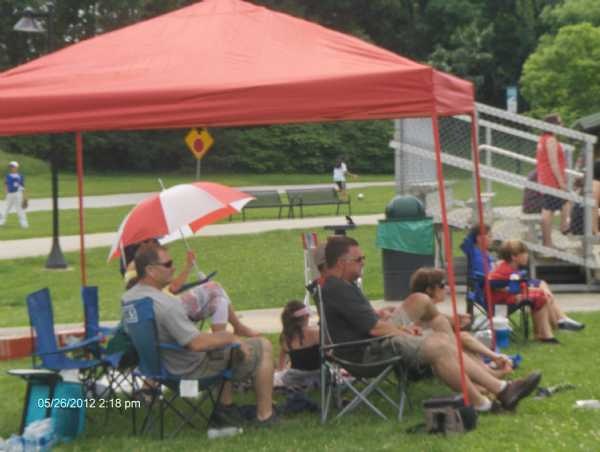 Parents making some shade!!! Wonder whats in the cups???