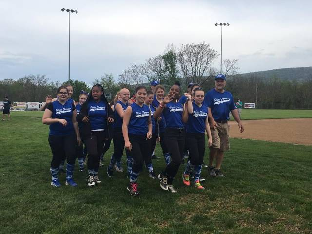 Coach Rich Bealer and his 12U Softball team