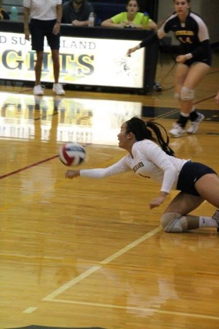 Aliah Bowllan digs ball against Mercy