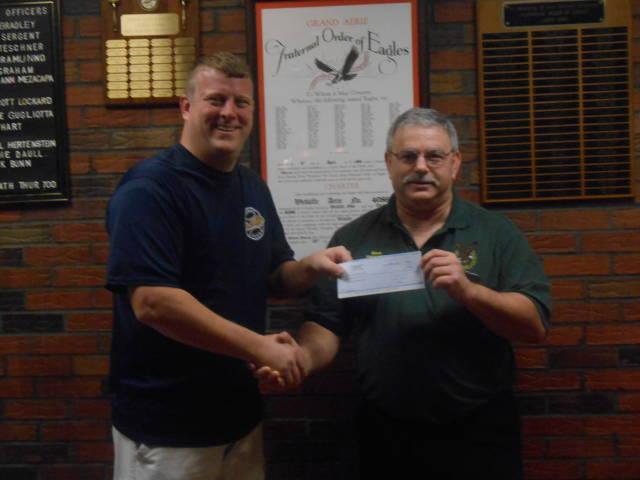 Wickliffe Eagles President Dave Sergent Presents $10,000 donation to Wickliffe Baseball Secretary Ed Levon